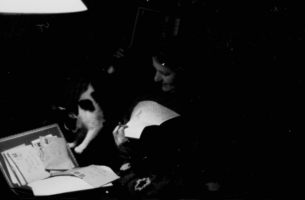 Negative - woman with cat and letter, Flickr, anyjazz65