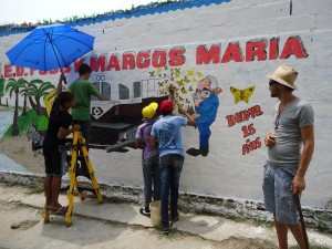 painting public walls in Aracataca, The Gypsy Residence