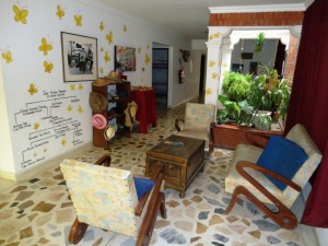 Living room with Garcia Marquez inspired decoration, in hotel The Gypsy Residence, Aracataca