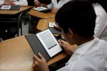 Niños con Tabletas leyendo Libros Digitales