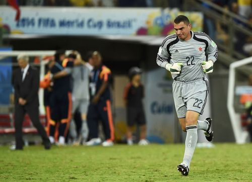 Colombia's goalkeeper Faryd Mondragon replaces David Ospina on the field during their 2014 World Cup Group C soccer match against Japan at the Pantanal arena in Cuiaba