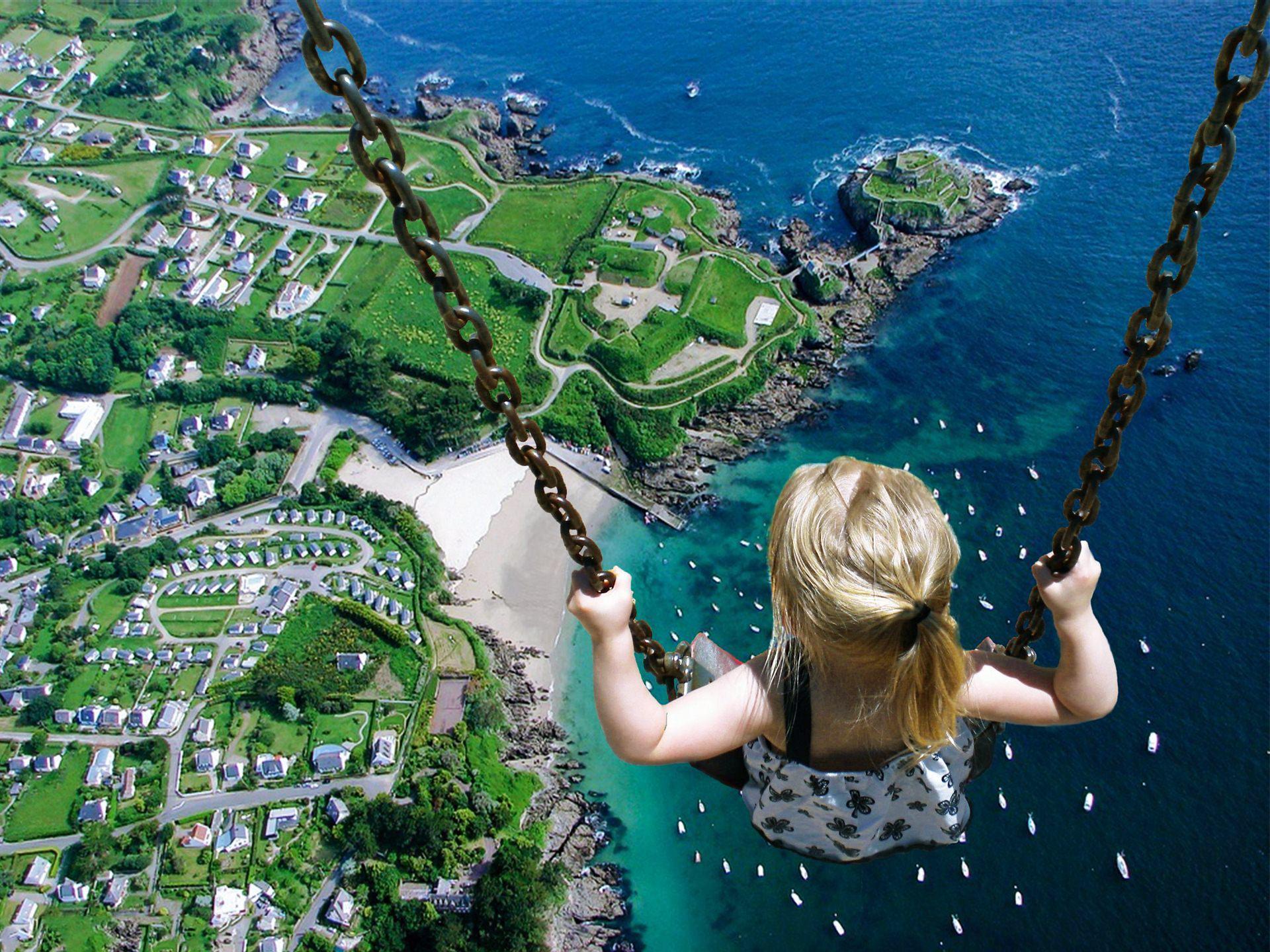 little-girl-on-swing-surreal