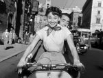 Audrey_Hepburn_and_Gregory_Peck_on_Vespa_in_Roman_Holiday_trailer.jpg