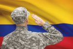 Soldier in hat facing national flag series - Colombia
