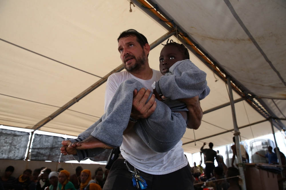Inego our logistician on board, holding a girl to the medical room on the Dignity 1.