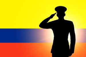 The Colombian flag and the silhouette of a soldier's military salute