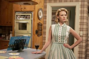 """[Molina, Genaro -- - LOS ANGELES, CA - JULY 8, 2008 -- Actress January Jones stands in the kitchen of her character Betty Draper on the set of the AMC television series, """"Mad Men,"""" at Los Angeles Center Studios in Los Angeles on July 8, 2008. The actress wears a dress designed from fashions from the early 60s which is the era of the award-winning television series.] *** []"""