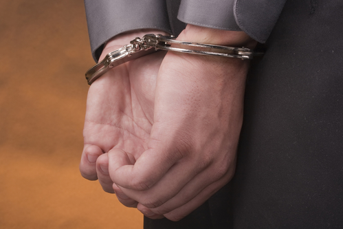 I arrested his hands handcuffed behind his back.