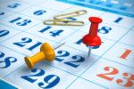 Pushpins and calendar. Shallow DOF effect
