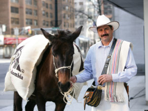 NEW YORK - MARCH 02: A man dressed as Juan Valdez and his mule Conchita poses as they hand out Colombian coffee at PIX Plaza on March 2, 2010 in New York City. (Photo by Dario Cantatore/Getty Images)
