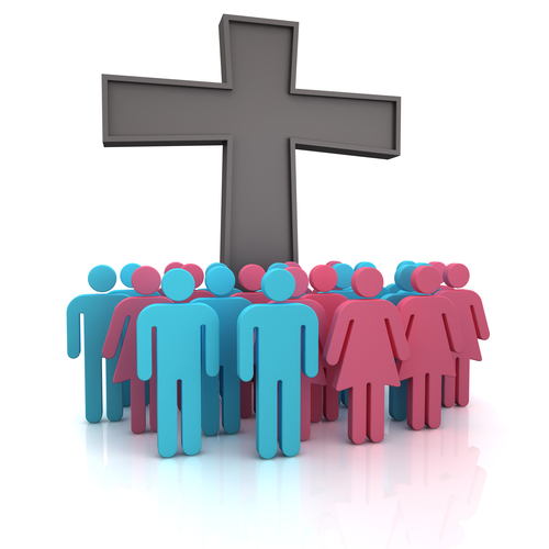 Group of the people standing at a christian cross