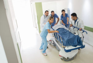 Group of doctors at the ER attending an emergency - healthcare and medicine concepts