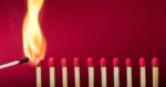Burning match setting fire to its neighbors